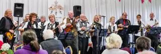 Uke-a-teers playing at a One Visions Housing Charity Concert at Firwood Bootle Cricket Club on 12th October 2017 (1 / 11)